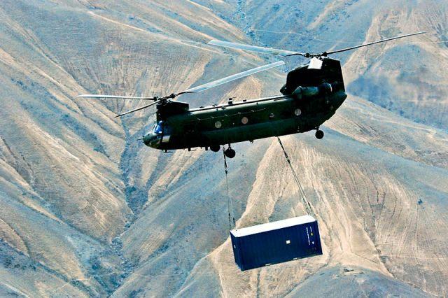Shipping Container Transport in Afghanistan https://commons.wikimedia.org/wiki/File:A_U.S._Army_CH-47_Chinook_helicopter_carries_a_sling-loaded_shipping_container_during_retrograde_operations_and_base_closures_in_the_Wardak_province_of_Afghanistan_131026-A-SM524-737.jpg
