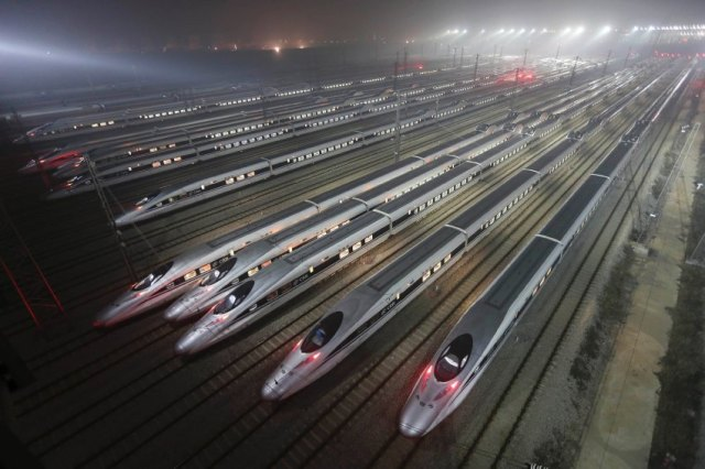 CRH380 (China Railway High-speed) Harmony bullet trains are seen at a high-speed train maintenance base in Wuhan, Hubei province, in this file photo taken December 25, 2012. A team of Chinese firms, along with the Export-Import Bank of China, are interested in designing, building, financing and maintaining California's proposed 800-mile high-speed rail project. REUTERS/Stringer CHINA OUT. NO COMMERCIAL OR EDITORIAL SALES IN CHINA